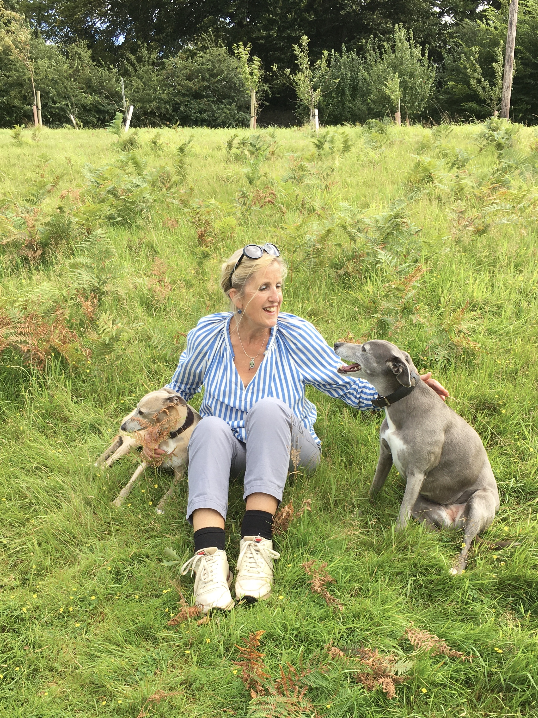 Caitlin with her Whippets Mimi and Luna