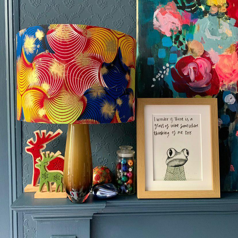 Colourful handmade African Lampshade with floral painting & illustrated print photo shoot. Collaboration between Detola and Geek & Tipperlilly Hill