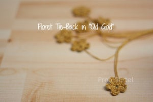 "Image of Floret Tie-Back in 0007 ""Old Gold"""