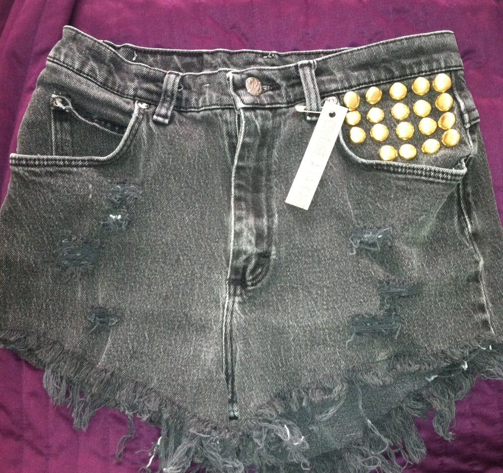 Image of studded ripped and destroyed shorts