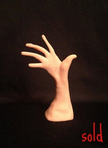 Image of A sculpture of a beautiful curved hand