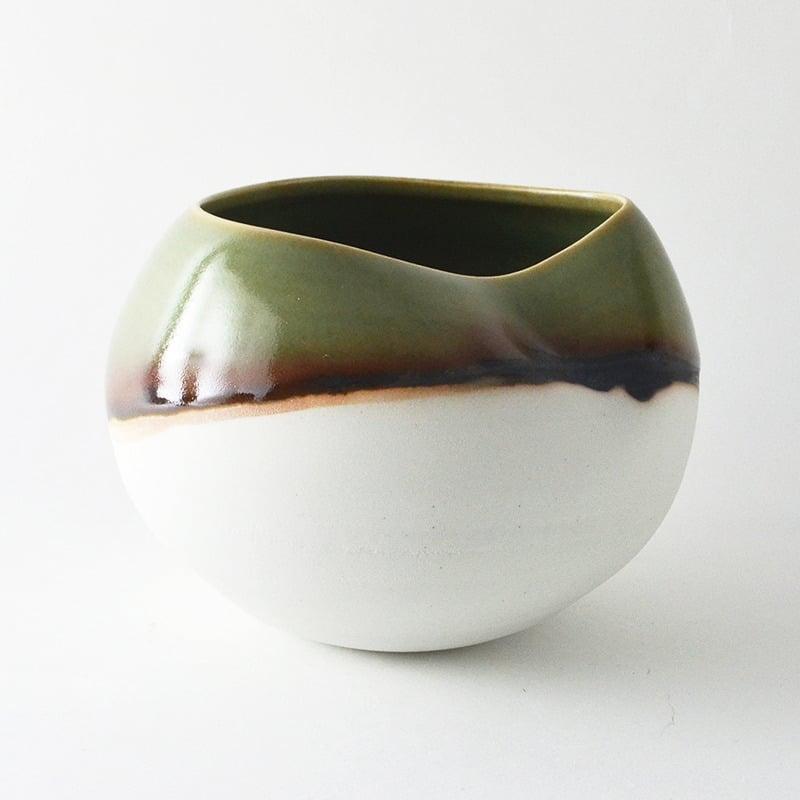 Image of altered porcelain globe bowl