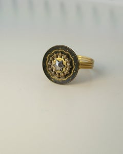 "Image of ""The Dark Star"" antique button ring"