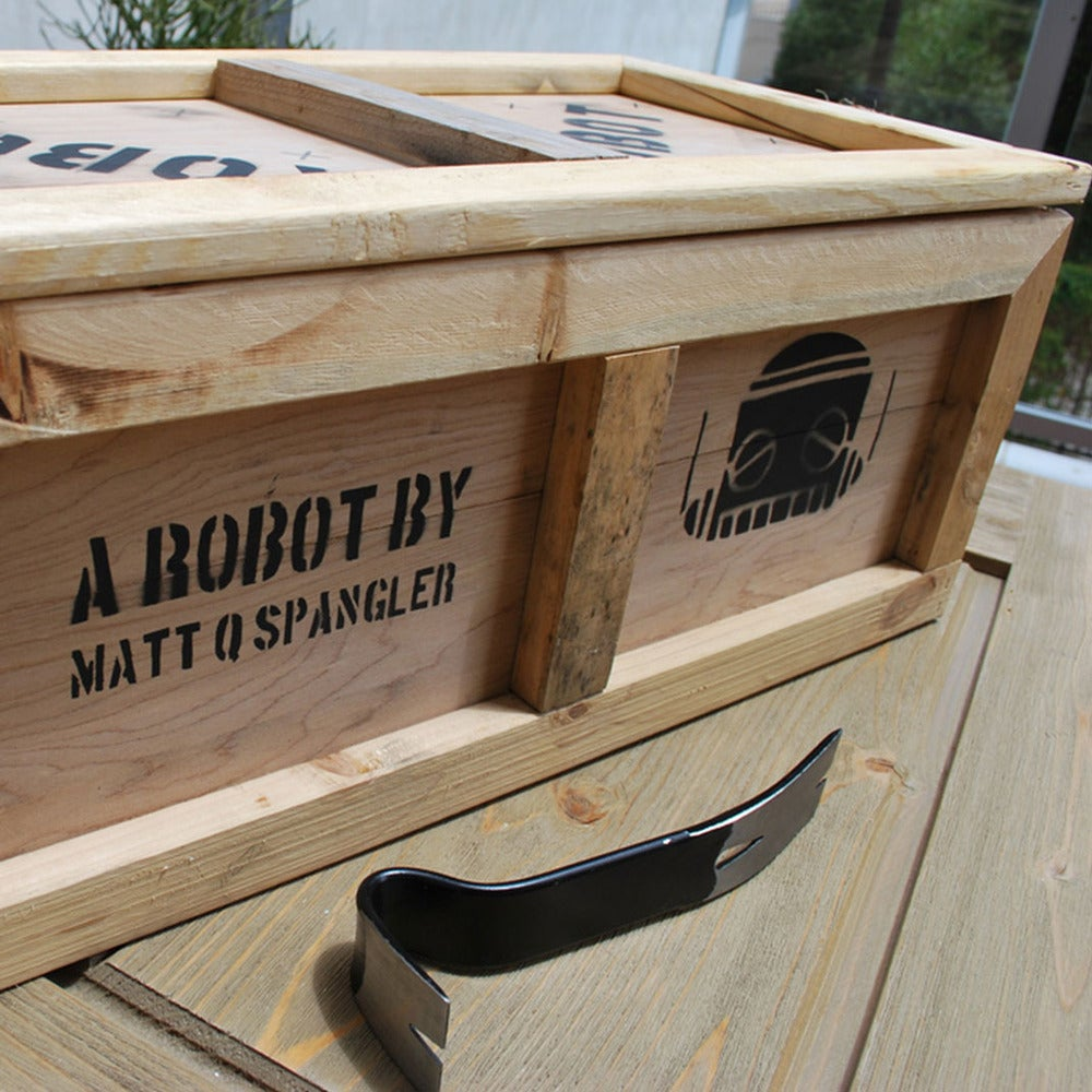 Image of Robot Plush and Shipping Crate