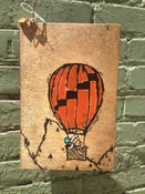 Image of Balloon. Banjo. Bird(on wood)