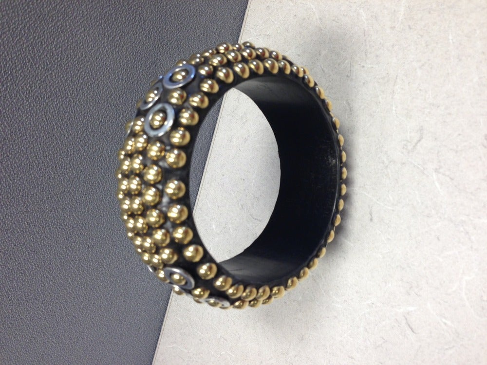 Image of Gold beaded wooden bangle