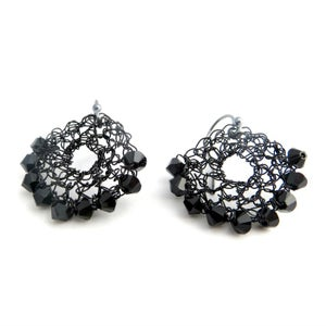 Image of Black hand crocheted half-moon wire earrings