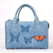 Image of Blue Carry-On with Insects