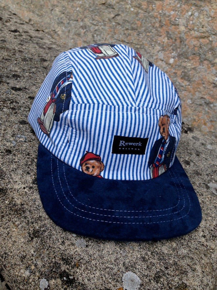 Image of 5 Panel cap with 'Ralph Bear' design and full suede peak