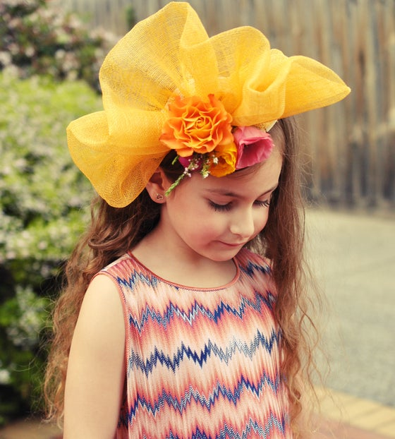 Image of Bright yellow wave fascinator