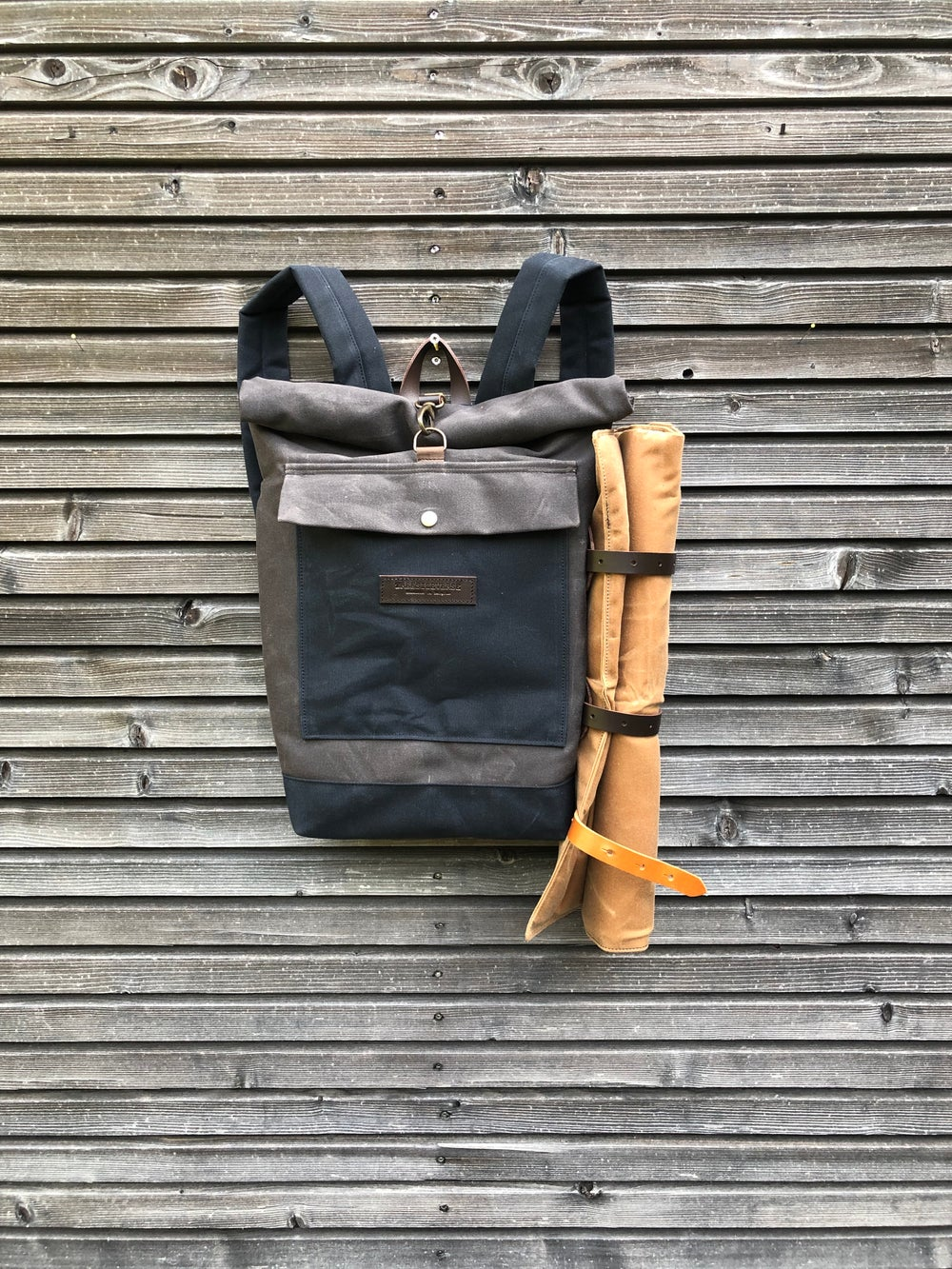 Image of Backpack in waxed canvas with detachable leather side straps and padded shoulder straps