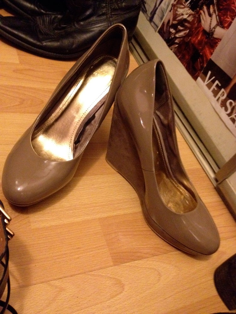 Image of taupe patent leather suede wedges