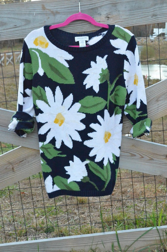 Image of Caught in a Daisy Sweater