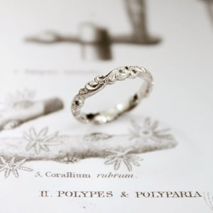 Image of platinum 3mm floral carved