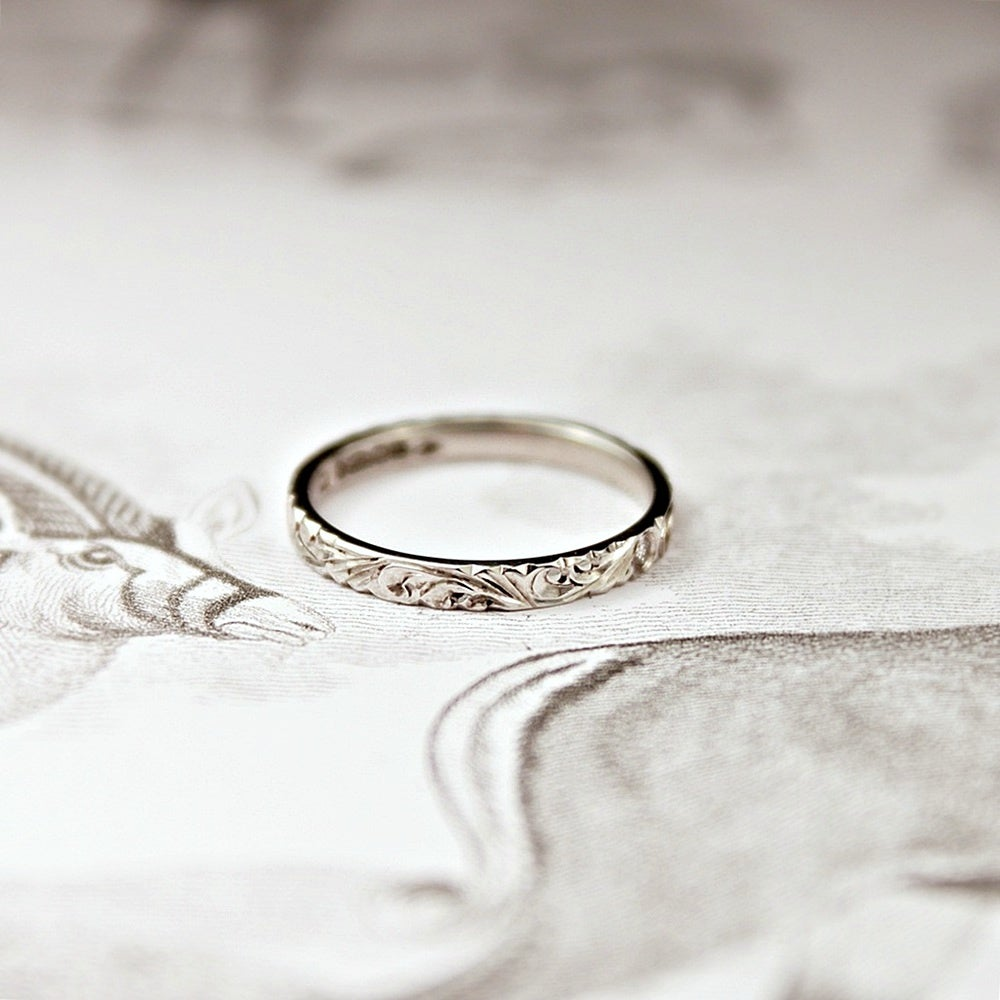 Image of platinum 2mm flat court floral engraved