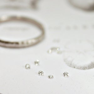 Image of 1.5mm brilliant~cut white diamond