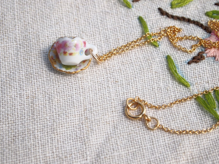 Image of gold lattice cup and saucer necklace