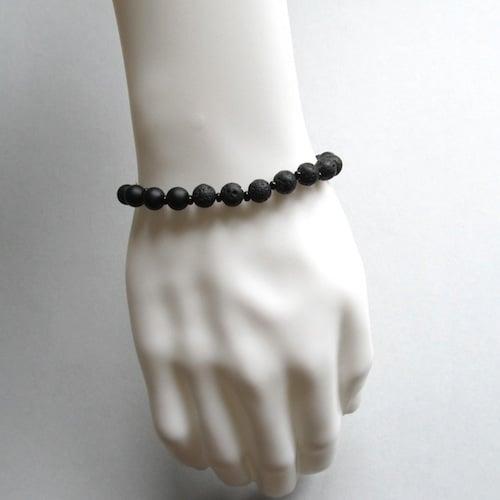 Image of Matt hematite and lava bead bracelet