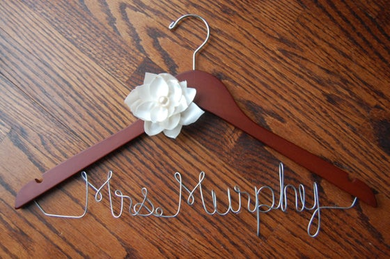 Image of customized wire name wooden hanger