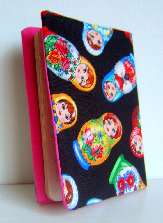 Image of Russian doll passport cover in rare matryoshka fabric