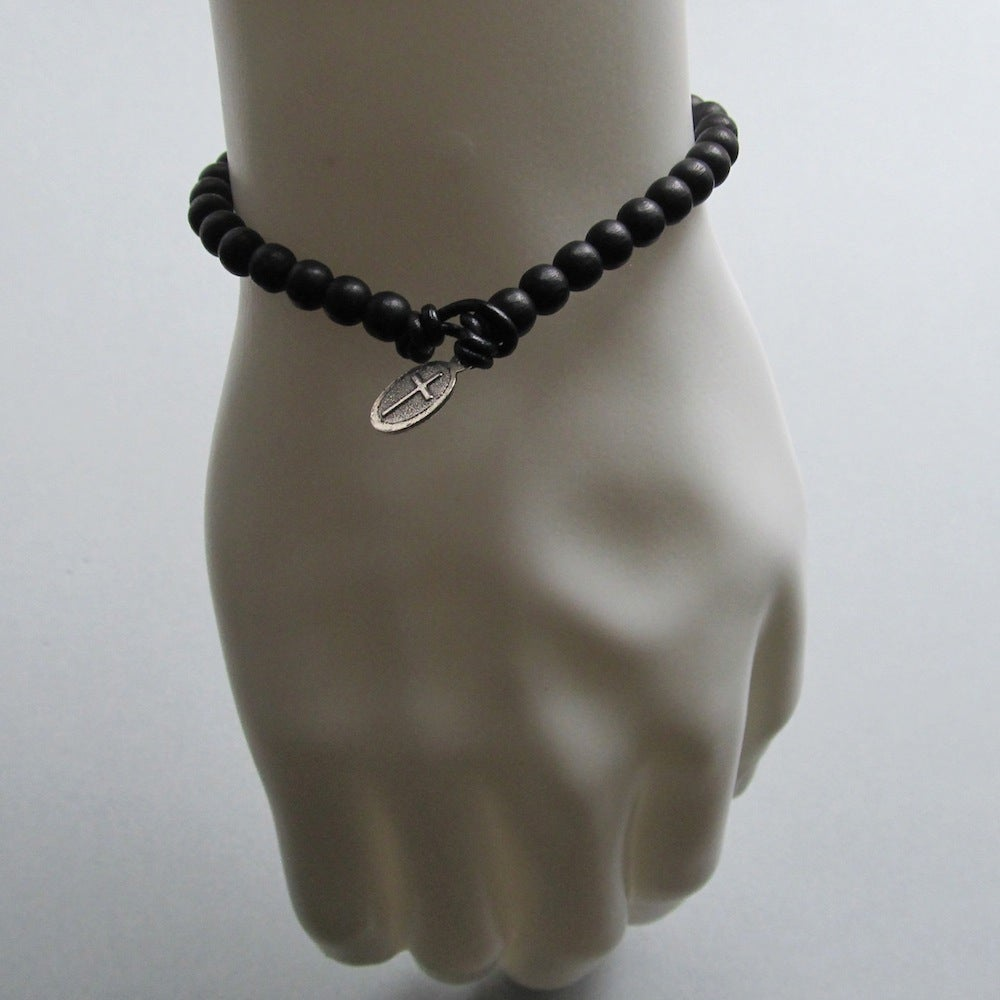 Image of Black beaded bracelet with cross fastening