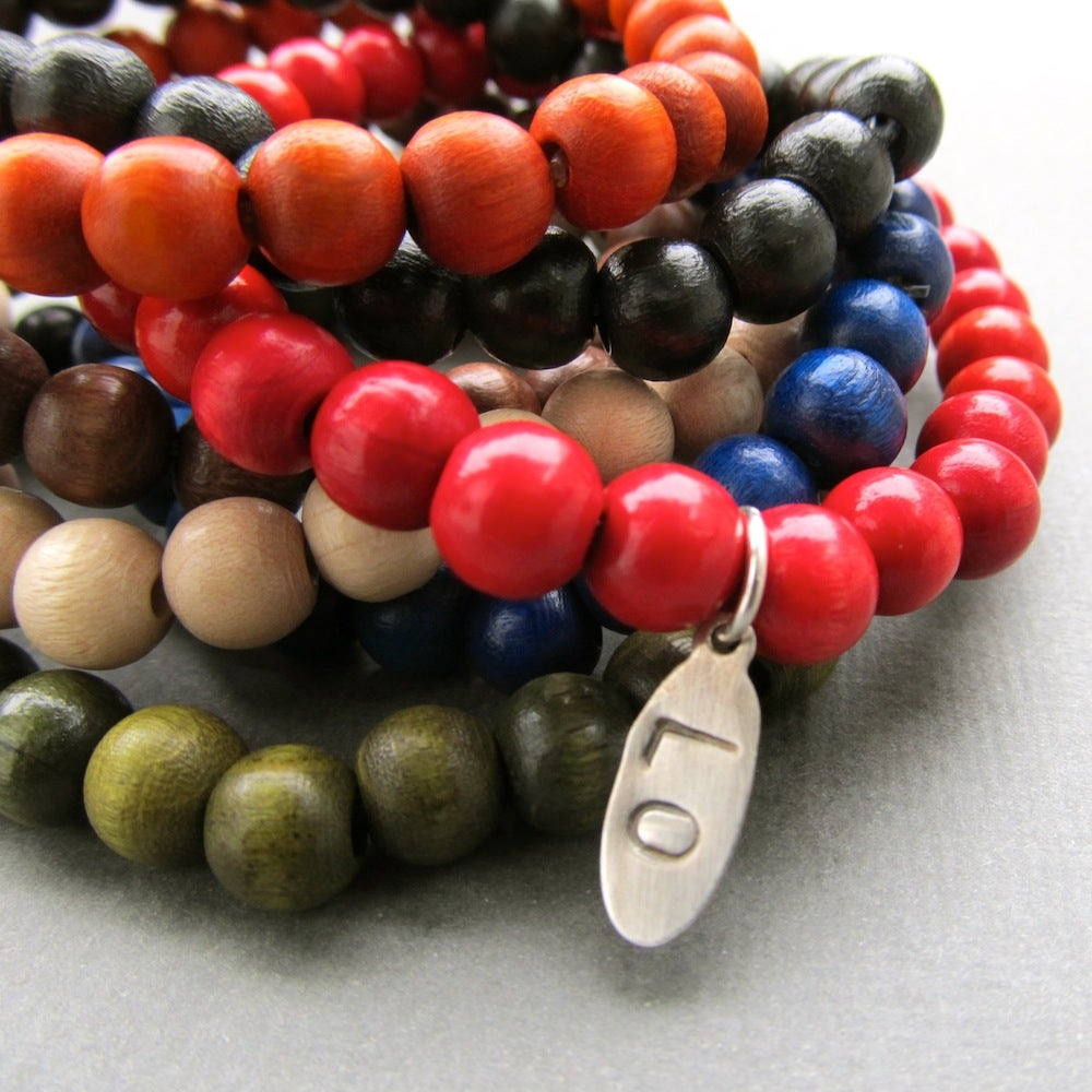 Image of Beaded bracelet with personalised initial tag