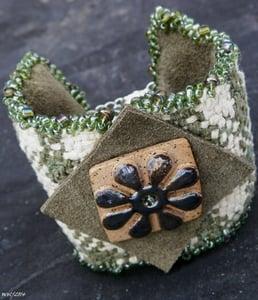 Image of SALE! Checkerboard Flower, handmade woven cuff with raku flower button