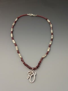 Image of Young Woman Necklace with Garnet Beads and Sterling Silver Beads