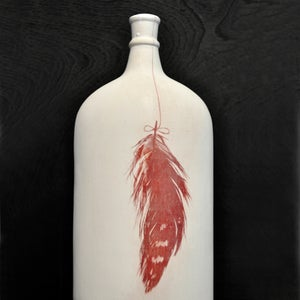 Image of feather bottle