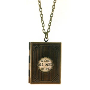 Image of We're All Mad Here, Alice In Wonderland Book Locket Pendant