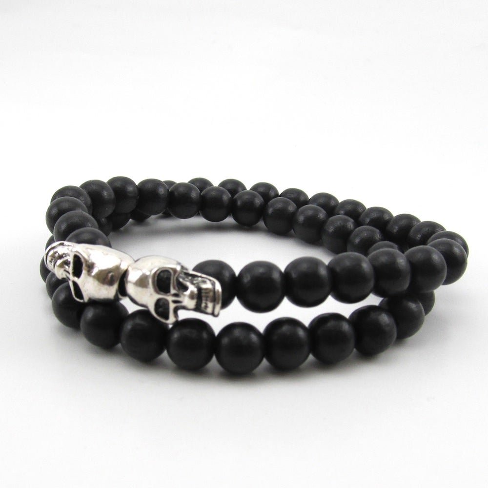 Image of Black beaded double skull double wrap bracelet
