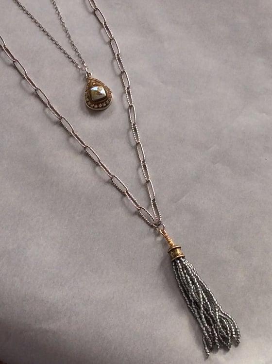 Image of tassel + pendant