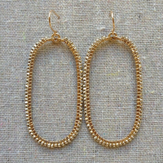 Image of Silver on gold beaded ovals