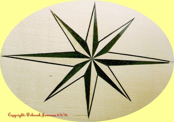 Image of Item No. 38.  Marquetry Inlay Nautical Star Design.