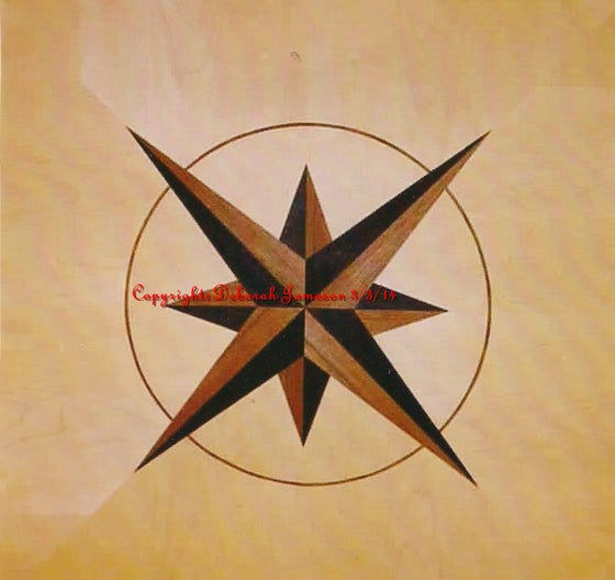 Image of Item No. 33. Satinwood And Black Star In A circle.