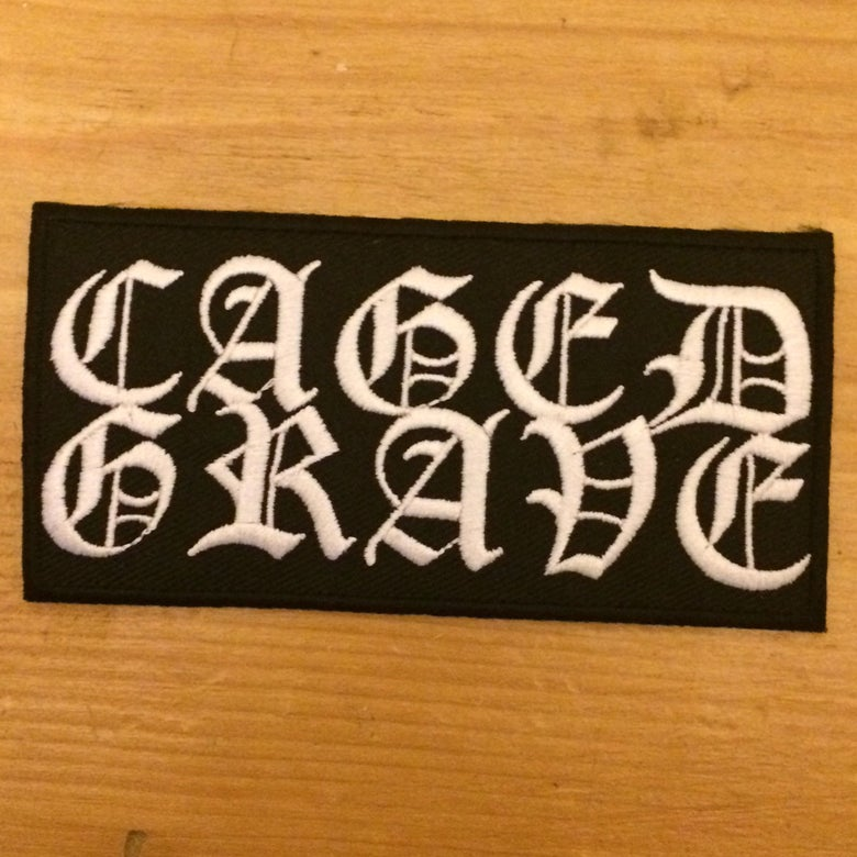 "Image of Caged Grave - Woven ""Iron-on"" Logo Patch"