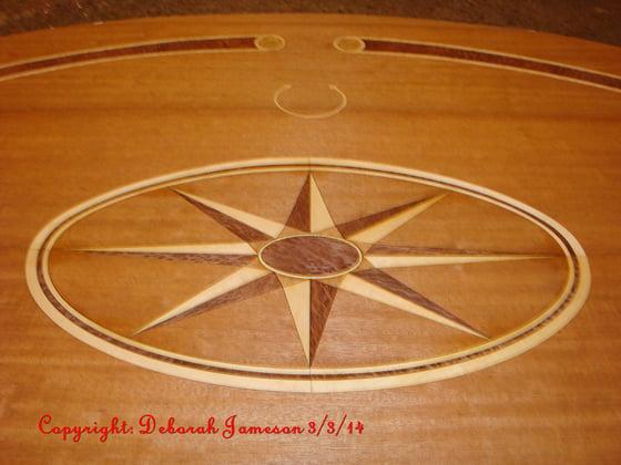 Image of Item No. 58. Compass Star xxxxx