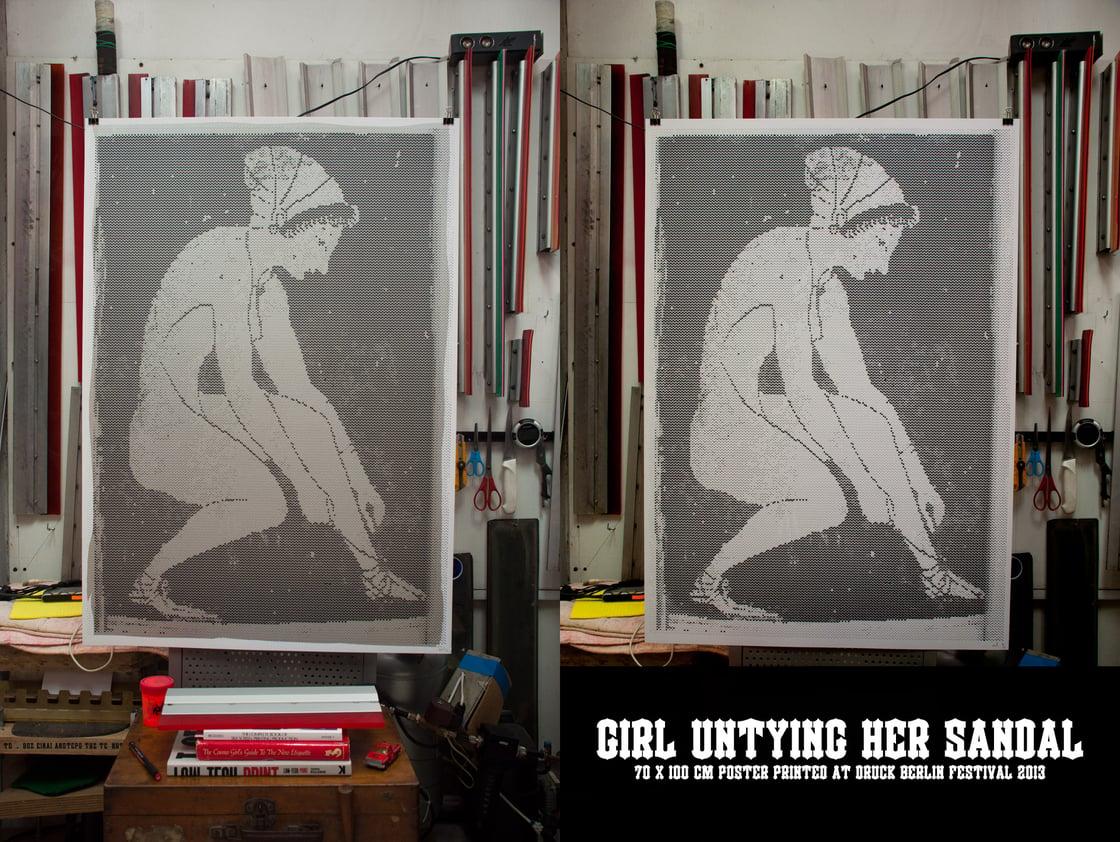 Image of Girl untying her sandal / Berlin style