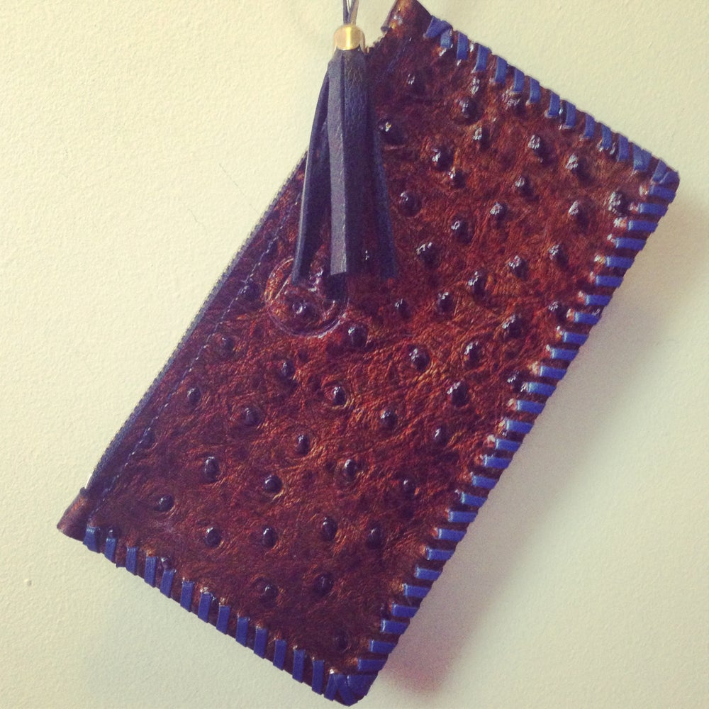 Image of patent metalic ostrich zip purse with blueberry stitching