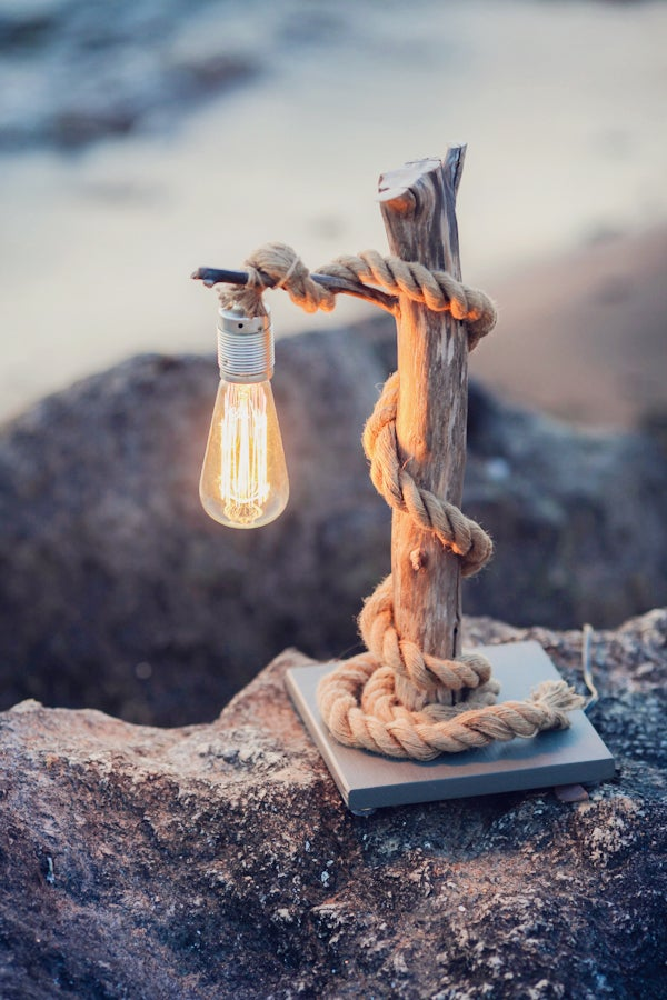 Image of Driftwood lamp with rope.