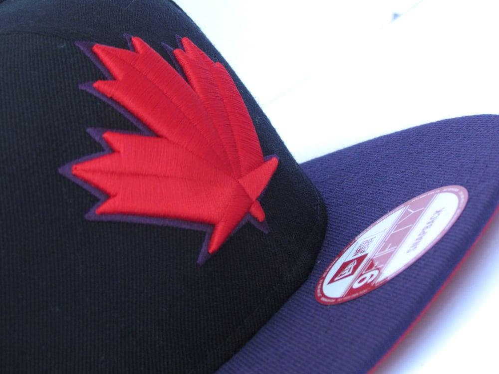 Image of TORONTO BLUEJAYS SPRING TRAINING BLK/PUR/RED SNAPBACK CAP