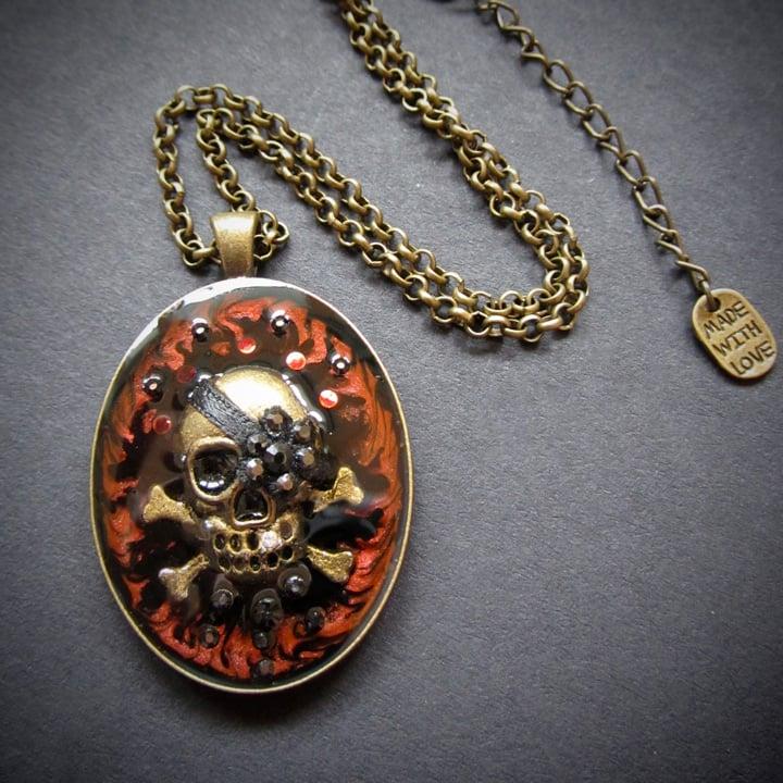 Ruby Rocks Skullie Bronze Pendant