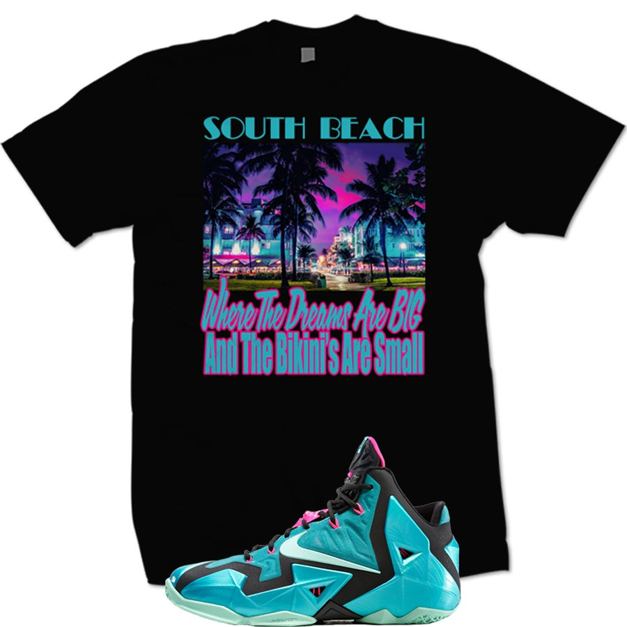 Image of LEBRON 11 SOUTH BEACH T SHIRT WHERE THE DREAMS ARE BIG AND THE BIKINI'S ARE SMALL - BLK -