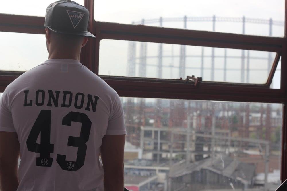 "Image of ""London 43"" White T-Shirt w/ Black Print"