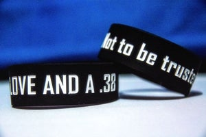 "Image of ""Not to be Trusted"" Rubber Bracelet"