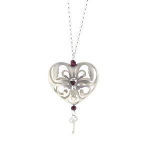 Image of Wonderland Peeping keyhole heart necklace