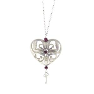Image of Wonderland Peeping keyhole heart necklace