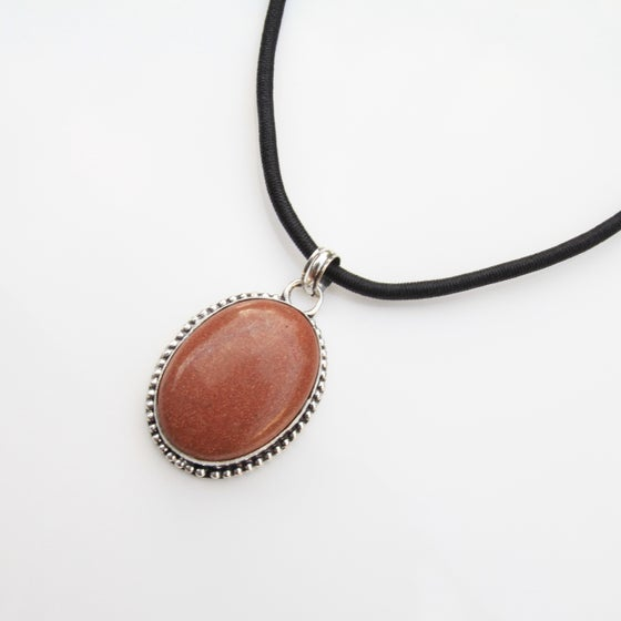 Image of Oval corded glitter stone necklace