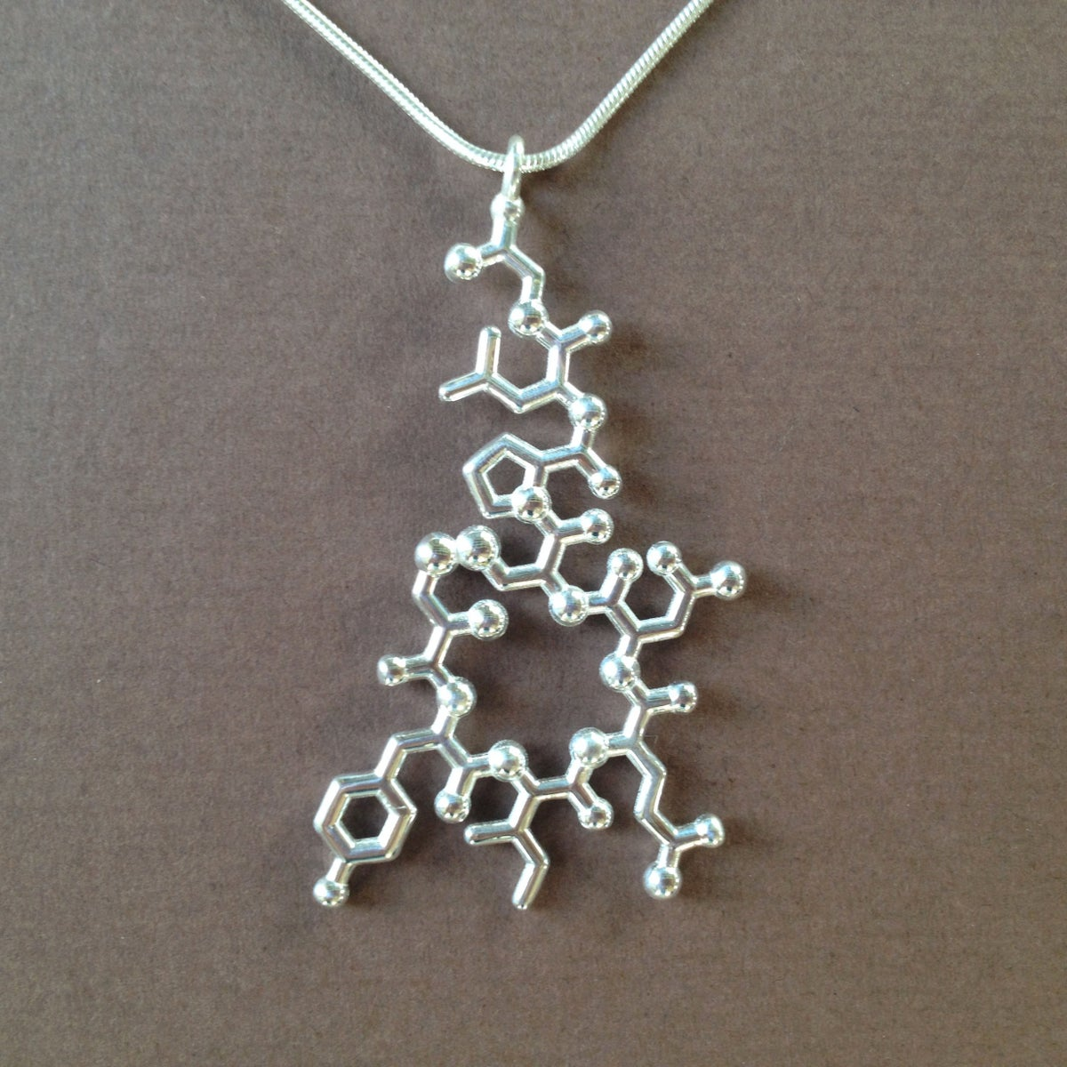 Image of oxytocin necklace - dangling