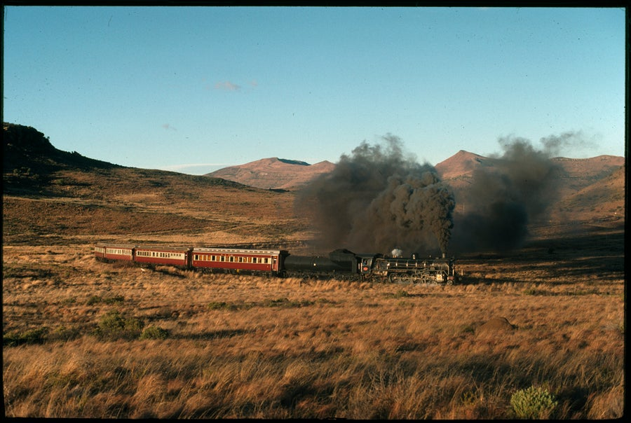 Image of A steam engine train making it's way across the plains